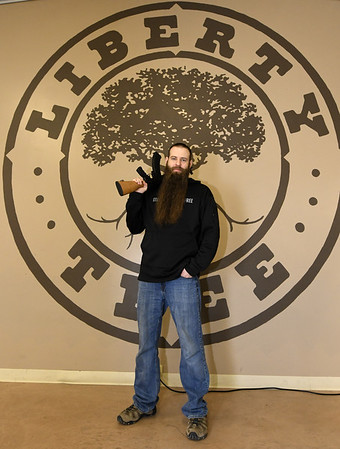 Liberty Tree owner Eli Bruton holds a WASR-10 semiautomatic rifle at his Carthage store on Thursday.<br /> Globe   Laurie Sisk