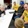 Joplin City Council candidate Doug Lawson, left, listens to firefighters and their families about their concerns during a meet and greet on Thursday night at the Joplin Public Library.<br /> Globe | Laurie Sisk