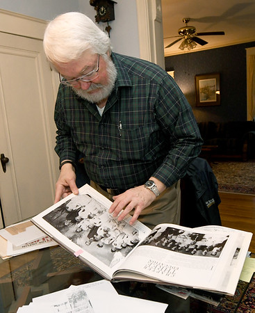 Murphysburg resident Jim Scott looks at a class photo of his great grandmother, Mildred Millisa Wilson Taylor, in his Murphysburg home.<br /> Globe   Laurie Sisk