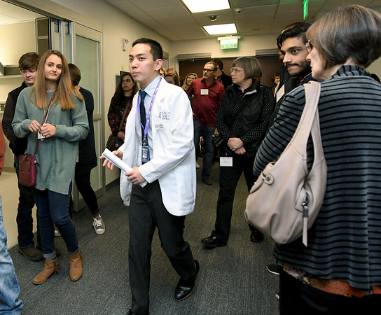Kansas City University Student Ambassador Felix Yew Kai Yuan leads accepted students and visitors on a tour of the Standardized Patient Lab during Accepted Students Day at KCU on Saturday.<br /> Globe | Laurie Sisk