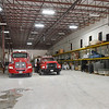Two of the Goodman Fire Protection District's trucks sit inside a Puppy's Choice warehouse on Thursday in Goodman. The department is leasing space from the business after their last space was destroyed in a tornado last year.<br /> Globe | Laurie Sisk