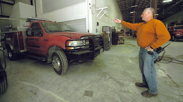 Goodman Area Fire Protection District Chief Keith Estes points out one of the department's trucks that was damaged in last year's tornado in Goodman.<br /> Globe   Laurie Sisk