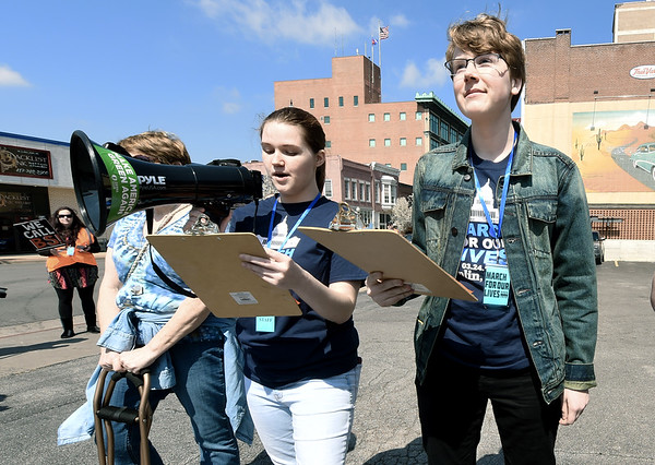 From the left: Webb City High School students Natally Starr and Derek Cole kick off the March for Our Lives rally on Saturday in downtown Joplin.<br /> Globe | Laurie Sisk