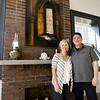 Developers Carolina and Jeff Neal stand in front of the historic fireplace they preserved at the recently renovated Hurlbut Building at 212 S. Joplin St.<br /> Globe | Laurie Sisk