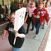 Marchers make their way down Main Street during the March for Our Lives rally on Saturday in downtown Joplin.<br /> Globe | Laurie Sisk