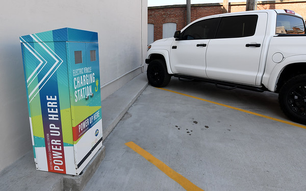 A charging station for electric vehicles sits in the north parking lot of the Hurlbut Building. Developers Jeff and Carolina Dean renovated the former mortuary and home of the Salvation Army to include numerous environmentally sound features.<br /> Globe | Laurie Sisk