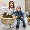 """From the left: Emy Thornburg, 5, and Brynna Thornburg, 3, spend a little time with """"Trevor"""" as they have their Easter portraits taken by photographer Russ Kinerson on Saturday at Wildcat Glades.<br /> Globe 