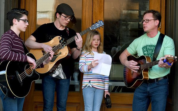 Members of the Sloan Family help get Third Thursday visitors into the St. Patrick's Day spirit with a liitle Irish music as the event kicks off its 10th year on Thursday in downtown Joplin. From the left: Connor Sloan, 15, Nick Sloan, 18, Katie Sloan, 10 and father, Jason Sloan.<br /> Globe | Laurie Sisk