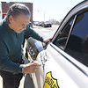 """Journalist, author and the voice of """"Sheriff"""" in the hit animated movie """"Cars,"""" Michael Wallis signs the """"Sheriff"""" car at Cars on the Route during a visit to Galena on Wednesday.<br /> Globe 
