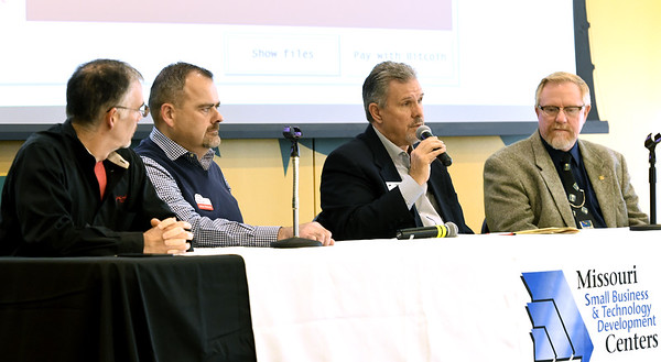 From the left: John Motazedi, owner of SNC Squared Technology Group, James Richards, CEO of Stronghold Data, Larry Hedin, senior business consultant for Oxen Technology and Charlie Davis, owner of Software Center, engage in a panel discussion of IT issues as they relate to cyber security during Cyber Awareness 360 on Friday at Missouri Southern.<br /> Globe   Laurie Sisk