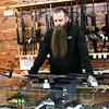 Liberty Tree owner Eli Bruton shares his political views during an interview at his Carthage store on Thursday.<br /> Globe | Laurie Sisk