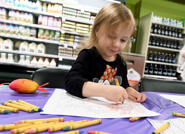 Three-year-old Addelyn Springer, of Webb City, gets in the Easter spirit at the coloring station at Natural Grocers during the store's Eggcellent Adventure on Friday. The event featured an Easter Egg Hunt, coloring station, prizes and more.<br /> Gobe   Laurie Sisk