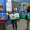 From the left: First place winner Landon Duke, 10 and runner up Adalynn Osborn, 11, hold their posters as Tom Walters, Community Development Planner for the City of Joplin, holds 10-year-old Tianna Taylor's poster during awards for the Community Housing Resource Board's Fair Housing Poster Contest on Tuesday at the Boys and Girls Club of Southwest Missouri. The top three posters will be exhibited on billboards in Joplin and all 21 entries will be displayed at City Hall. All top three entries also received an art kit. Duke received a $125 award, Osborn a $75 award and Taylor will receive a $50 gift certificate.