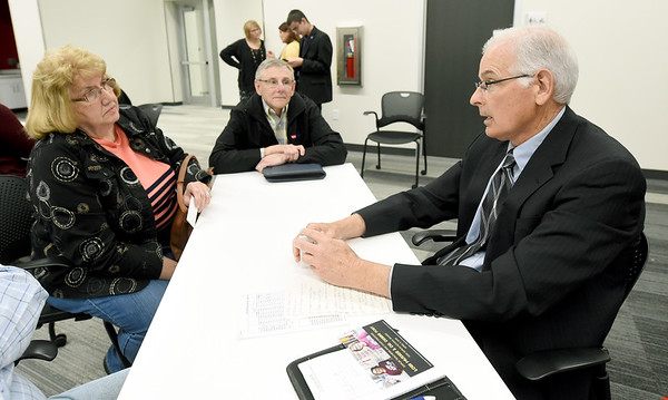 Zone 4 City Council candidate Morris Glaze, right,  discusses the future of Memorial Hall with Linda Brash, left and Connect2Culture CFO Clifford Wert during a candidate meet and greet on Thursday night at the Joplin Public Library.<br /> Globe | Laurie Sisk
