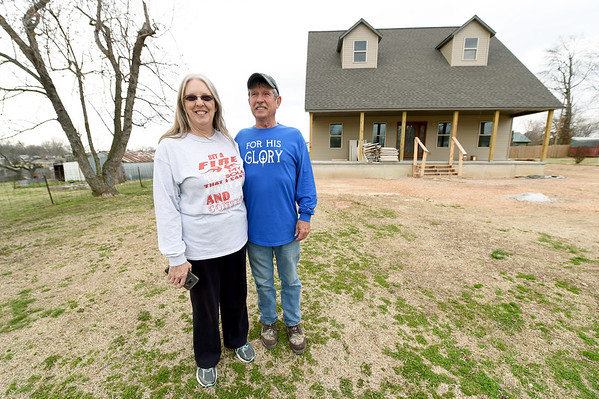 From the left: Connie and Gary Willman stand near their nearly completed new home on Thursday in Goodman. The couple lost their last home - which Gary lived in for 44 years - in last year's tornado. The new home sits to the left of their old home.<br /> Globe   Laurie Sisk