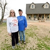 From the left: Connie and Gary Willman stand near their nearly completed new home on Thursday in Goodman. The couple lost their last home - which Gary lived in for 44 years - in last year's tornado. The new home sits to the left of their old home.<br /> Globe | Laurie Sisk