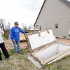 From the left: Connie and Gary Willman stand near their storm cellar, where they sought refuge from last year's Goodman tornado. The cellar stands to the right of their home that was destroyed and to the left of their new home, which is nearing completion.<br /> Globe | Laurie Sisk