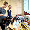 From the left: Sisters Kayley Schurman, 15 and Avery Schurman, 14, check out some of the scores of purses at the First United Methodist Church's annual rummage sale on Wednesday at the church. Proceeds from the annual sale go to benefit the church's youth mission work.<br /> Globe | Laurie Sisk