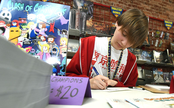Joplin senior Bailey Greninger creates a Korean Pop character during Free Comic Book Day on Saturday at Hurley's Heroes. Greninger is one of about 40 members of the Joplin High School Cartoonist Club.<br /> Globe | Laurie Sisk