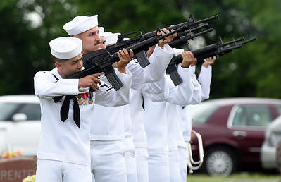 Sailors from a Tinker, Okla. honor guard pay their respects to Seaman 1st Class Clifford George Goodwin at Diamond Cemetery on Saturday. Goodwin was killed at Pearl Harbor 77 years ago, when he was 24-years-old. Globe | Laurie Sisk