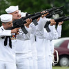 Sailors from a Tinker, Okla. honor guard pay their respects to Seaman 1st Class Clifford George Goodwin at Diamond Cemetery on Saturday. Goodwin was killed at Pearl Harbor 77 years ago, when he was 24-years-old.<br /> Globe | Laurie Sisk