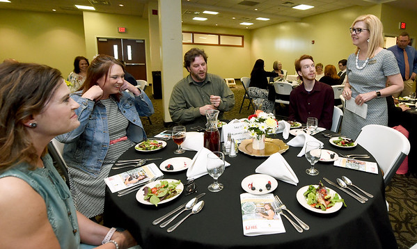 Joplin RVIII Superintendent Melinda Moss, right, visits with JHS student Ian Miller, second from right and hisn family and guests during The Joplin Globe All-Area Academic Excellence Team 32nd Honor Banquet on Tuesday night at Missouri Southern. Globe | Laurie Sisk