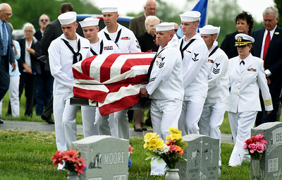 Sailors from the U.S. Naval Reserve in Springfield carry the remains of Seaman 1st Class Clifford George Goodwin to a final resting place at Diamond Cemetery on Saturday. Goodwin was killed at Pearl Harbor 77 years ago, when he was 24-years-old. Globe | Laurie Sisk