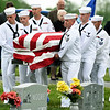 Sailors from the U.S. Naval Reserve in Springfield carry the remains of Seaman 1st Class Clifford George Goodwin to a final resting place at Diamond Cemetery on Saturday. Goodwin was killed at Pearl Harbor 77 years ago, when he was 24-years-old.<br /> Globe | Laurie Sisk