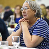 Annie Baxter Award winner and Executive Director of the Lafayette House Alison Malinowski Sunday listens as Dot Wilcoxson chronicles some of Malinowski Sunday's contributions to the Joplin community during the Annie Baxter Award Ceremony on Wednesday at Missouri Southern.<br /> Globe | Laurie Sisk