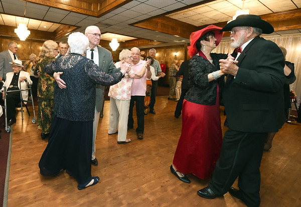 Senior Prom guests crowd the dance floor during the Area Agency on Agency's Senior Prom on Wednesday at The Butcher's Block. About 300 area seniors attended the annual prom, which began about 10 years ago. Globe | Laurie Sisk
