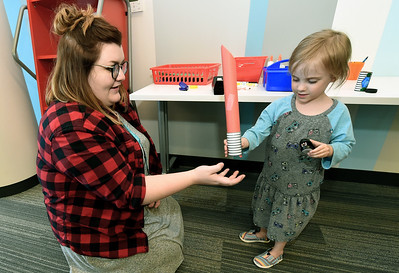 Three-year-old McKenna Cox gets a handcrafted light saber that she and Children's Assistant Allie Jones created during a Star Wars celebration on Saturday at the Joplin Public Library. Children were treated to visits with costumed characters, crafts, movies and more during the event. Globe | Laurie Sisk