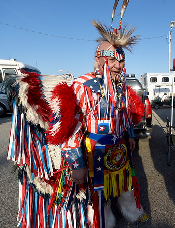 Senior Vice President of the Marine Corps League Robert Alexander stands in colorful patriotic dress during Rodeo Miami on Saturday at the Miami Fairgrounds. Alexander, a Creek indian, served as a Marine for more than 3 decades. Globe | Laurie Sisk