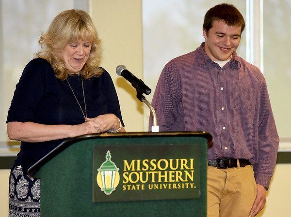 Carl Junction teacher XXX Good talks about her prize pupil, Taylor Howard, during The Joplin Globe All-Area Academic Excellence Team 32nd Honor Banquest on Tuesday night at Missouri Southern.<br /> Globe | Laurie Sisk