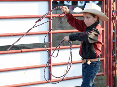 Eight-year-old Manny Ramirez, of Parsons, Kan., practices his roping skills at Rodeo Miami on Saturday at the Miami Fairgrounds. Globe | Laurie Sisk