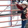 Eight-year-old Manny Ramirez, of Parsons, Kan., practices his roping skills at Rodeo Miami on Saturday at the Miami Fairgrounds.<br /> Globe | Laurie Sisk