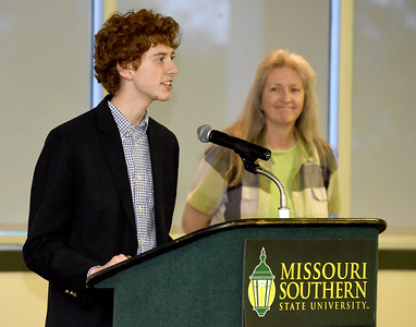 College Heights Christian School's Daniel Estep refelects on the positive impact his teacher, Mrs. Stanley has had on him both academically and personally during The Joplin Globe All-Area Academic Excellence Team 32nd Honor Banquet on Tuesday night at Missouri Southern. Globe | Laurie Sisk