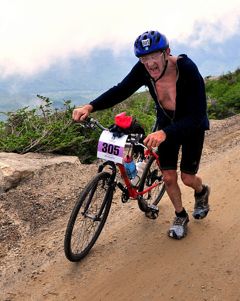Ray Gengenbach, 75, of Amherst, NH, pushes his bike up a difficult section of the Mt. Washington Auto Road, during The 5th Annual Newton's Revenge bicycle race, held on July 11th. The event, up the 7.6 mile course, was won by 32 year old Tom Danielson, of Boulder, Colorado, with a time of 49.32.