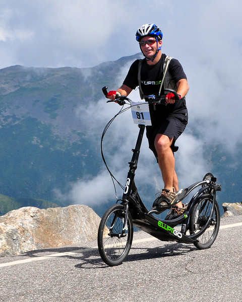 """The 5th Annual Newton's Revenge bicycle race, up the 7.6 mile course of The Mt. Washington Auto Road, in Pinkham Notch, Gorham, NH, was held on Sunday, July 11th, 2010. Bryce Whiting rides an """"Elliptigo"""", based on the elliptical trainer, up the 7.6 mile course to the summit of the 6,288' Mt. Washington."""