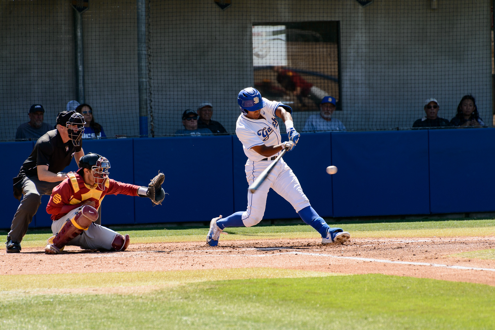 Freshman Armani Smith hits the ball into the right field.