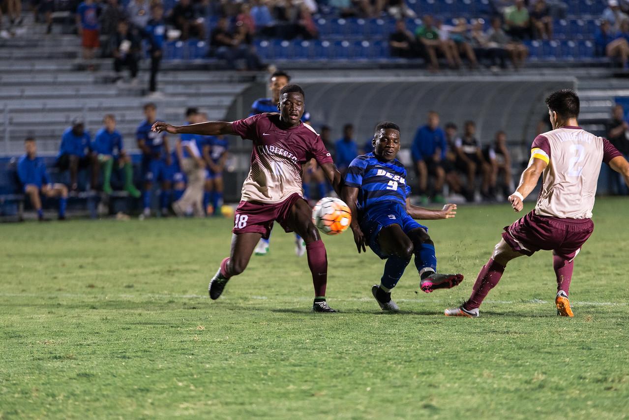 Sophomore Ahinga Selemani shoots on goal after juking two Charleston defenders.
