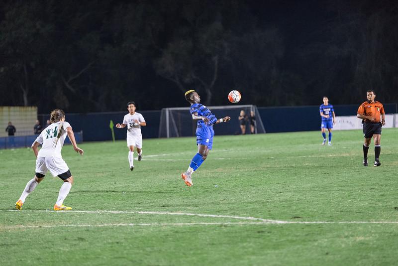 Ahinga Selemani controls the ball with his chest.