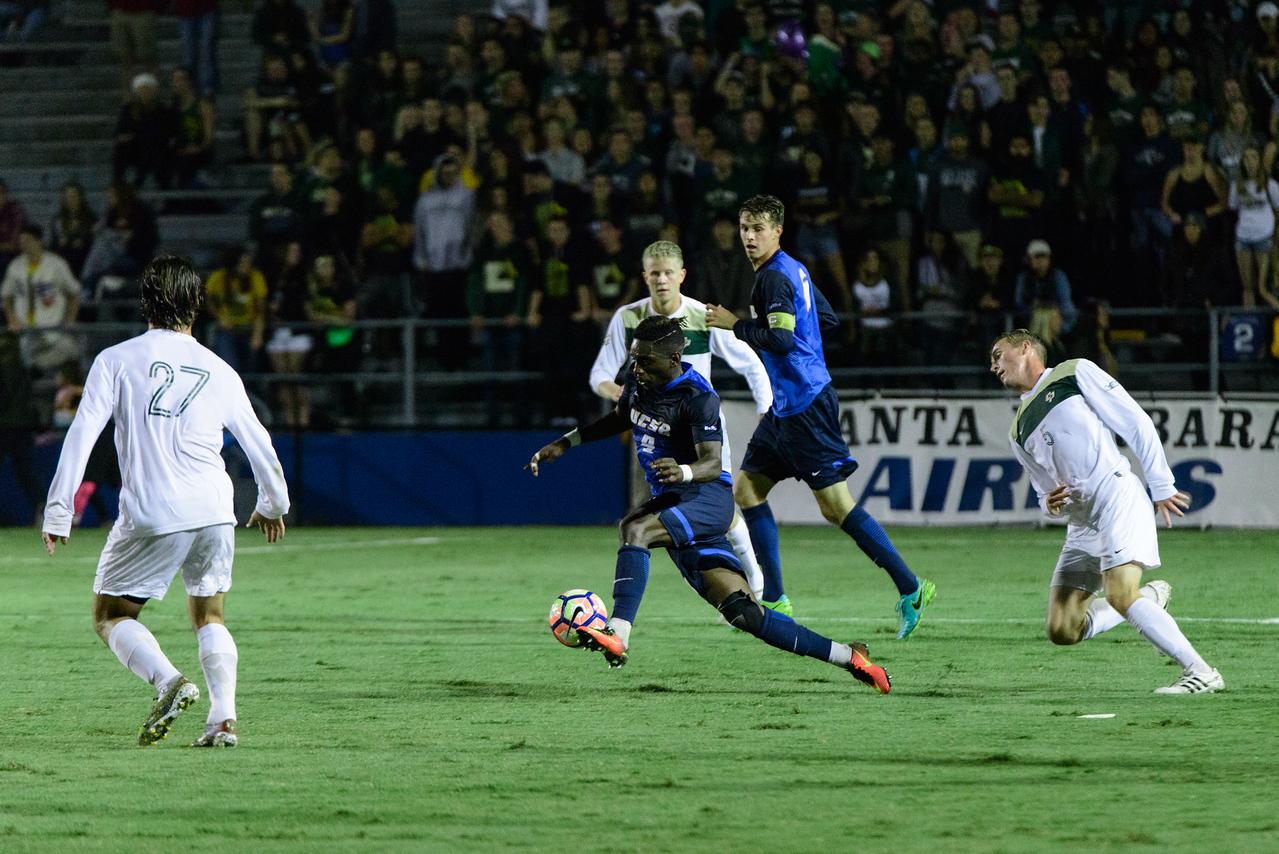 Ahinga Selemani rushes forward to keep control of the ball.