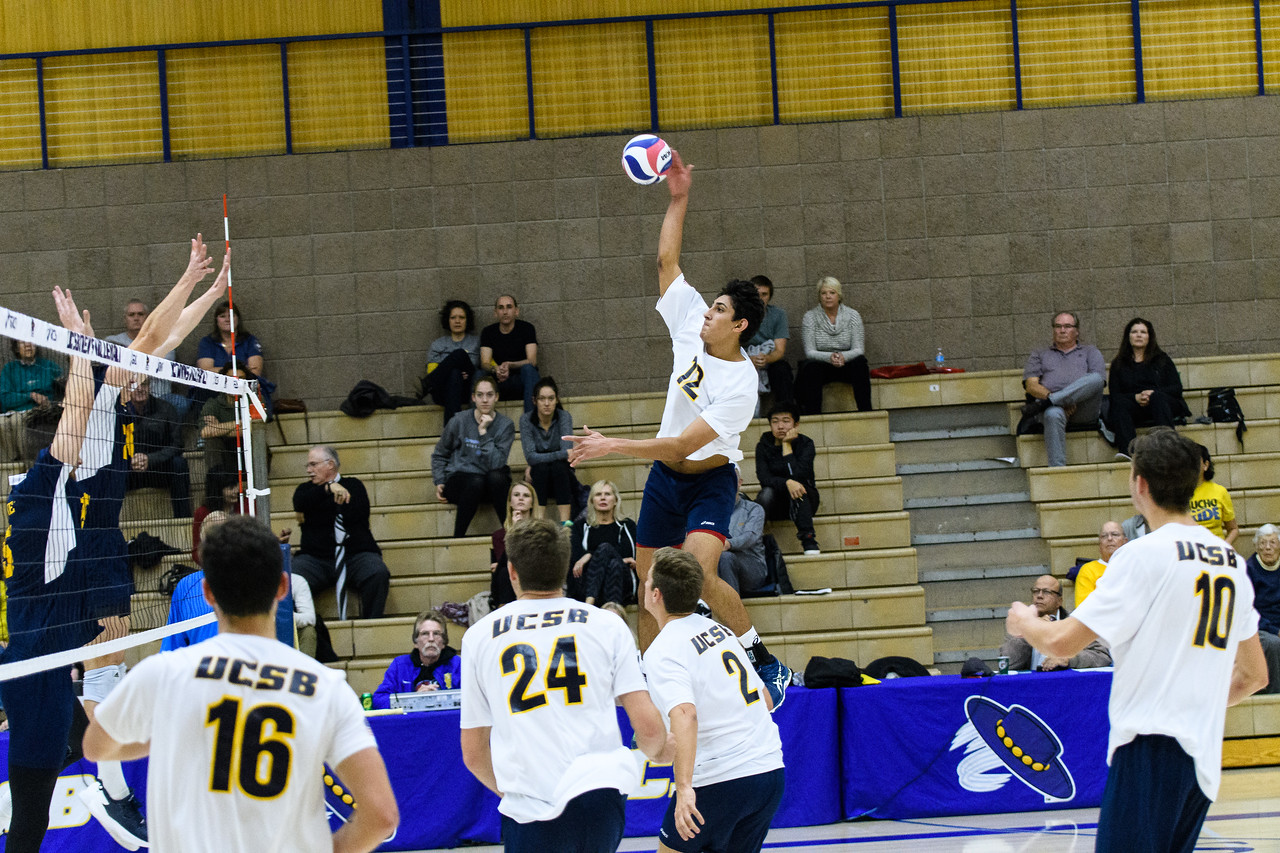Corey Chavers swings from off the net over the UC Irvine blockers.