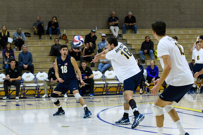 Hayden Boehle handle serve-receive as Parker Boehle calls the ball.