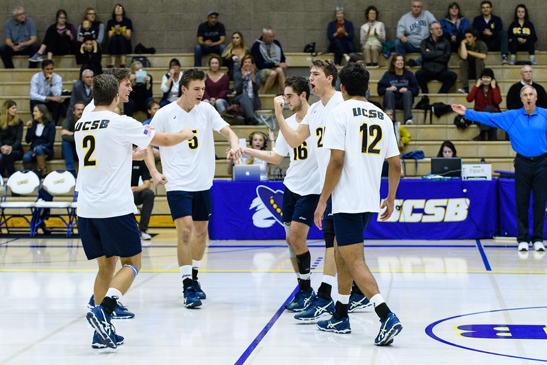 After a series of scrappy plays, the Gauchos celebrate a kill to take set 2 and even up the game.