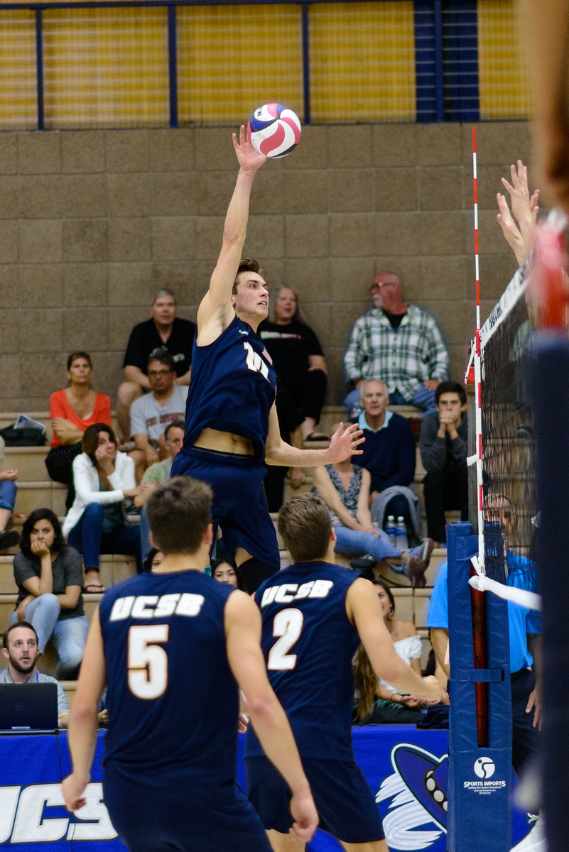 Seeing the block, Jacob Delson adjusts his swing into a roll shot for the point.