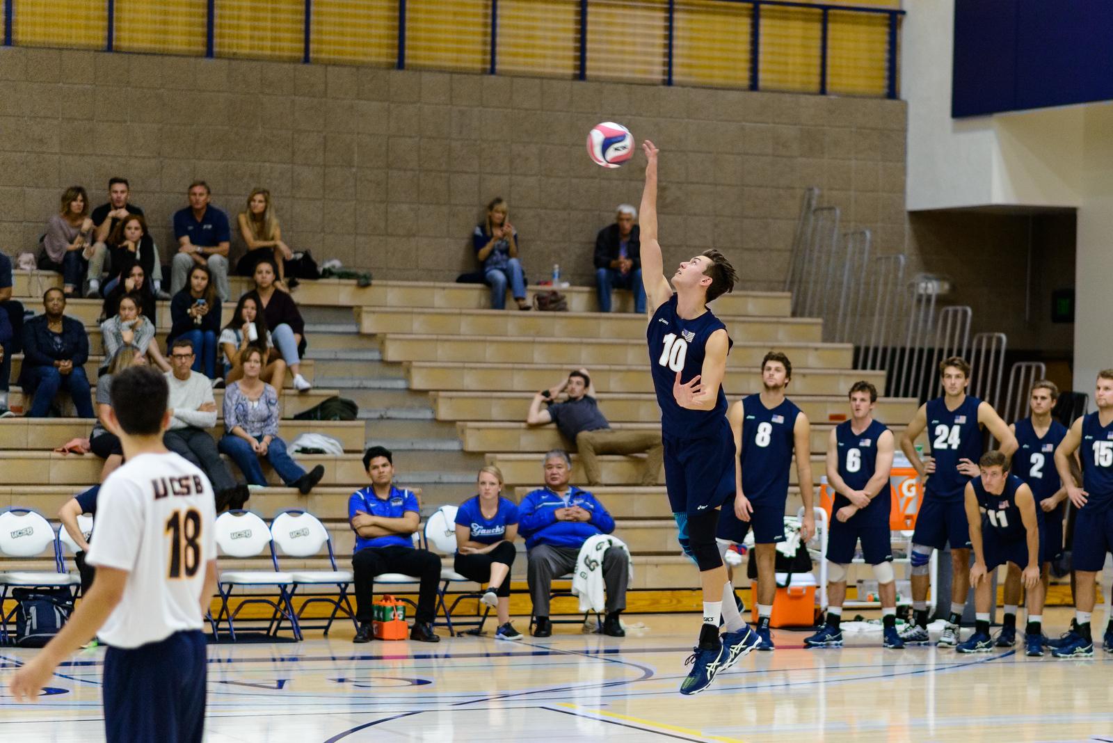 Jacob Delson serves a jump serve.