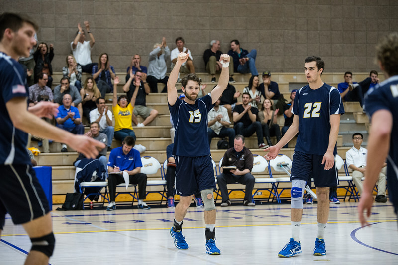 Kevin Donohue raises his arms with solid happiness, winning the point early in the first set.