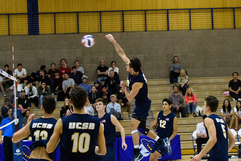 Attacking from the back row, Hayden Boehle rips a solid hit through the CSUN defense.