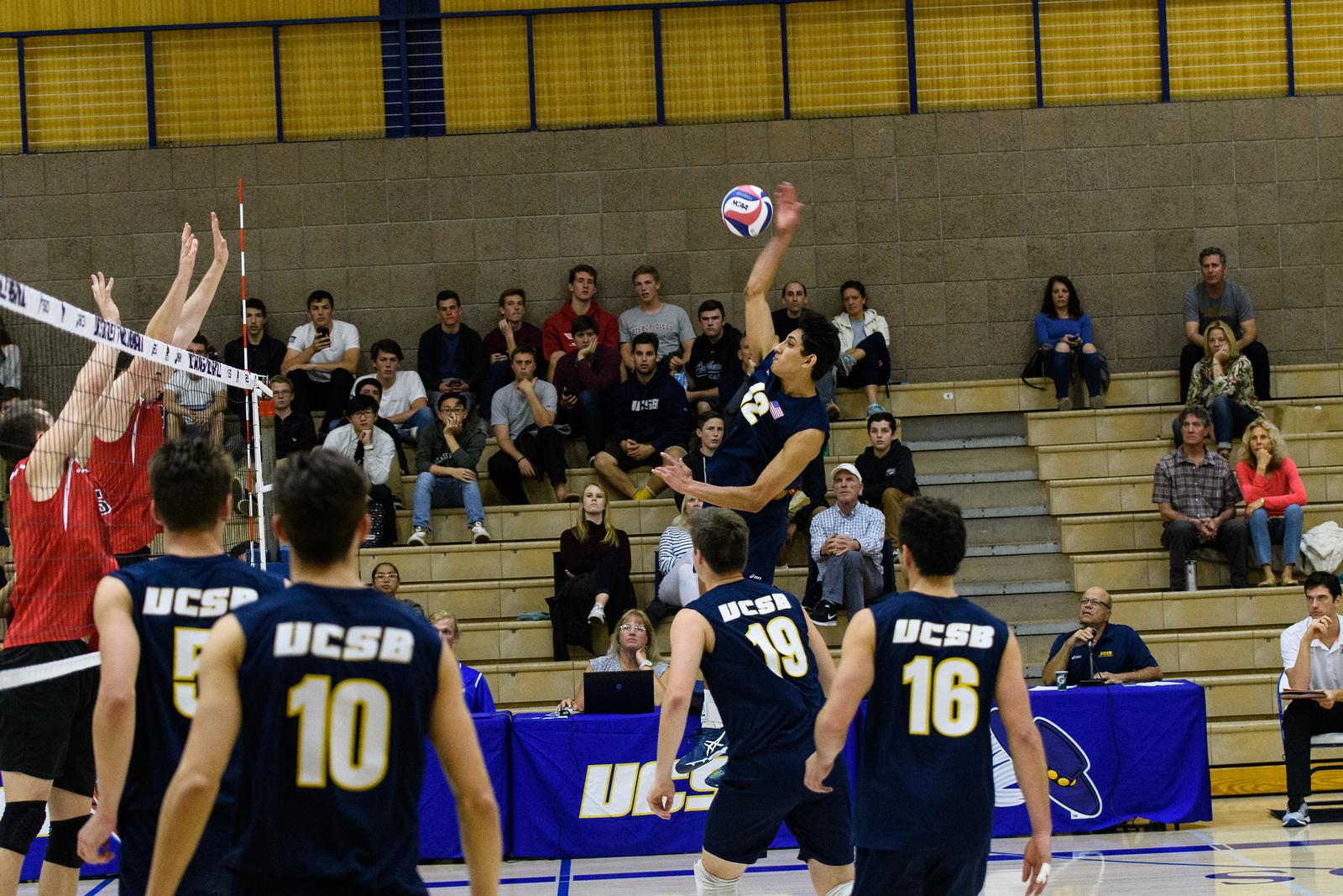 Corey Chavers swings over the CSUN block